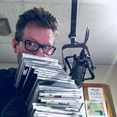 Kevin O'Connor with stack of CDs